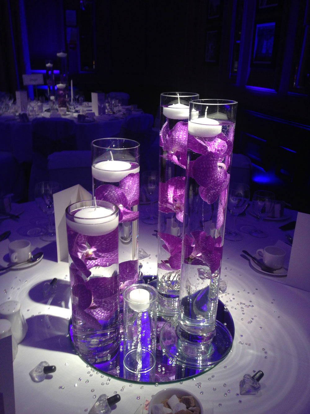 Modern purple glass vases orchids candles