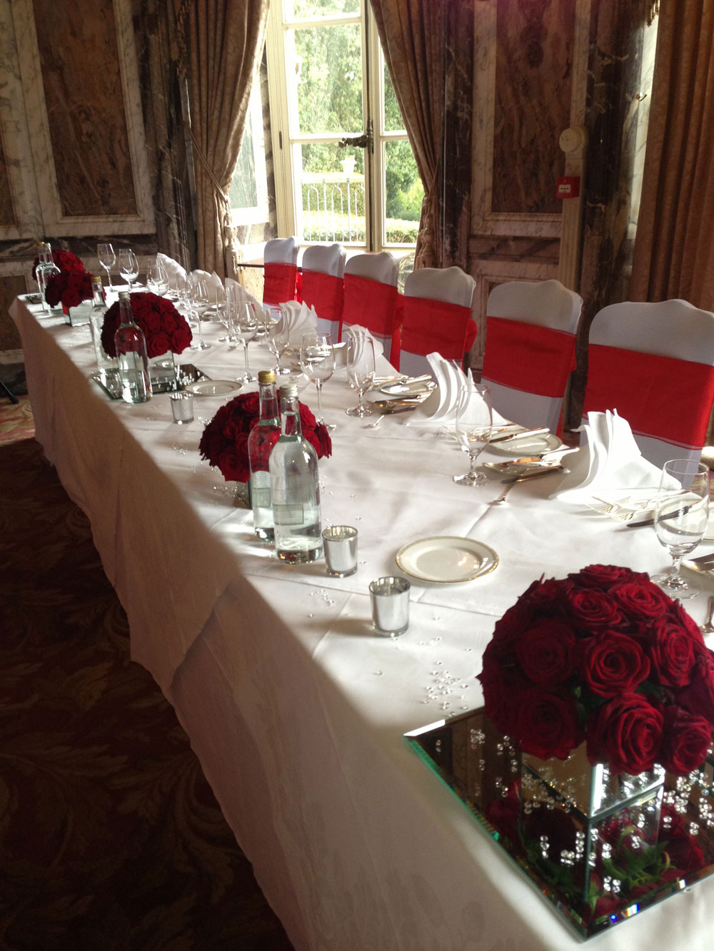 Opulence wedding top table red roses